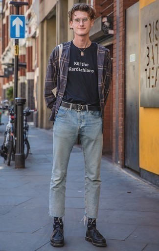 How to Wear Black Leather Desert Boots: Uber dapper and functional, this casual combo of a navy plaid long sleeve shirt and light blue jeans provides with wonderful styling possibilities. Bring an elegant twist to an otherwise mostly casual look by slipping into black leather desert boots.