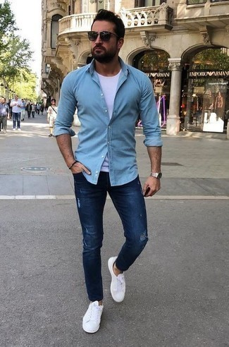 How to Wear a Black Bracelet For Men: A light blue long sleeve shirt and a black bracelet are amazing menswear items to have in your current casual repertoire. White canvas low top sneakers will instantly elevate even the most basic getup.