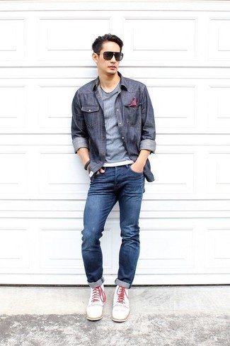 How to Wear a Navy Chambray Long Sleeve Shirt For Men: This pairing of a navy chambray long sleeve shirt and blue jeans looks awesome and instantly makes you look cool. Wondering how to finish this ensemble? Wear a pair of white canvas casual boots to smarten it up.