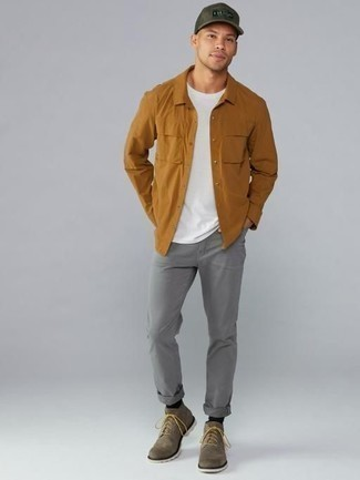 Men's Looks & Outfits: What To Wear In 2020: A tobacco long sleeve shirt and grey jeans are the kind of a winning casual outfit that you need when you have no time. Finishing with a pair of brown suede casual boots is a surefire way to give an added touch of style to this outfit.