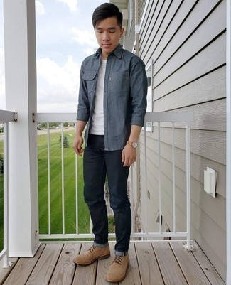 How to Wear a Navy Chambray Long Sleeve Shirt For Men: For a cool and relaxed look, team a navy chambray long sleeve shirt with navy jeans — these two pieces fit really nice together. Rounding off with tan suede casual boots is an effective way to bring a bit of fanciness to this look.