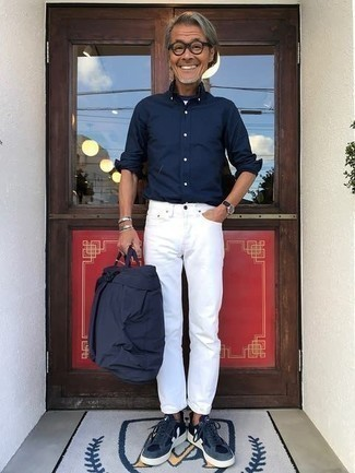 Navy Long Sleeve Shirt Outfits For Men After 50: A navy long sleeve shirt and white jeans are the perfect base for a casually dapper look. The whole getup comes together perfectly when you complement this ensemble with navy and white canvas low top sneakers. This pairing demonstrates that as a 50-year-old gent, you still have a vast array of sartorial options.