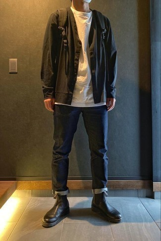 Black Long Sleeve Shirt Outfits For Men: If the setting allows a casual look, marry a black long sleeve shirt with navy jeans. For a more elegant touch, complete this look with a pair of black leather chelsea boots.