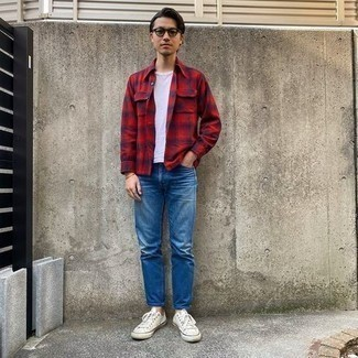 Blue Pants with Red Shirt Outfits For Men: A well pieced together combo of a red shirt and blue pants will set you apart instantly. Balance out this outfit with a more refined kind of shoes, such as this pair of white canvas low top sneakers.