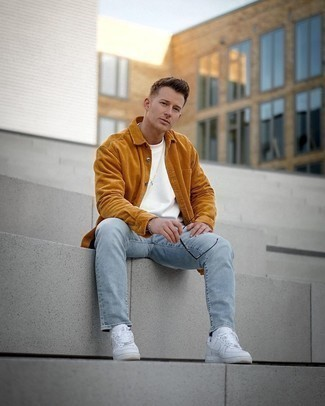 White and Red Leather Low Top Sneakers Outfits For Men: A tobacco corduroy long sleeve shirt and light blue jeans are a great getup to have in your day-to-day fashion mix. White and red leather low top sneakers complement this look quite well.