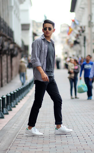 Black Jeans Outfits For Men In Their Teens: This casual combo of a white and black gingham long sleeve shirt and black jeans is super easy to put together without a second thought, helping you look amazing and ready for anything without spending a ton of time searching through your wardrobe. We adore how a pair of white and green leather low top sneakers makes this outfit whole. This getup shows that as a teen, you have a vast array of dressing options.