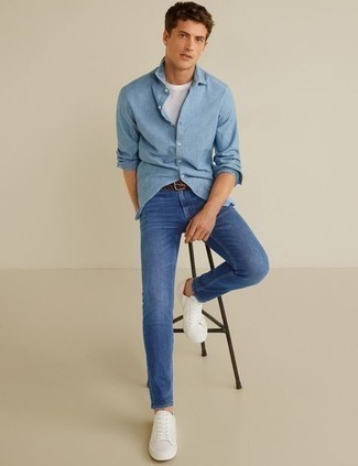 Light Blue Long Sleeve Shirt Outfits For Men: This pairing of a light blue long sleeve shirt and blue jeans makes for the perfect base for a casually stylish ensemble. Let your styling skills really shine by complementing your outfit with a pair of white canvas low top sneakers.