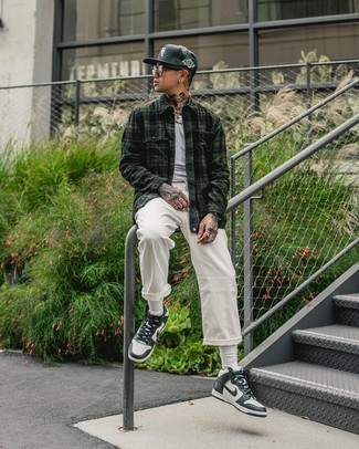 White Jeans Outfits For Men: You'll be surprised at how easy it is for any gent to get dressed this way. Just a dark green plaid long sleeve shirt paired with white jeans. When this getup appears all-too-dressy, play it down with white and green leather high top sneakers.