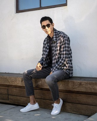 Charcoal Jeans Outfits For Men: Make a black and white plaid flannel long sleeve shirt and charcoal jeans your outfit choice for a dapper, casual look. The whole look comes together when you complete this look with a pair of white canvas low top sneakers.