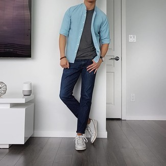 Charcoal Crew-neck T-shirt Outfits For Men: Perfect the cool and relaxed look in a charcoal crew-neck t-shirt and navy jeans. The whole look comes together if you complement your getup with a pair of white leather low top sneakers.