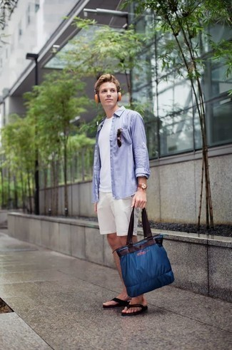How to Wear a Navy Canvas Tote Bag For Men: Wear a light blue long sleeve shirt and a navy canvas tote bag if you're scouting for a look option for when you want to look casual and cool. You can get a little creative with shoes and complete this outfit with a pair of black flip flops.
