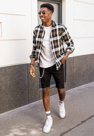 How to Wear a Long Sleeve Shirt For Men: Putting together a long sleeve shirt with black denim shorts is a smart option for a casually cool getup. A pair of white leather low top sneakers is a never-failing footwear option here that's full of personality.