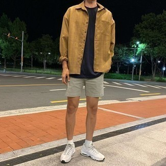 Mint Shorts Outfits For Men: To don a casual ensemble with a fashionable spin, reach for a tan plaid long sleeve shirt and mint shorts. For a more casual spin, why not introduce white athletic shoes to your outfit?