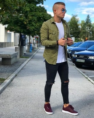 Team an olive long sleeve shirt with black ripped skinny jeans to be both casual and cool. Up the ante of your look with burgundy low top sneakers. You know when it's super hot outside, sometimes only a cool outfit like this one can get you through the day.