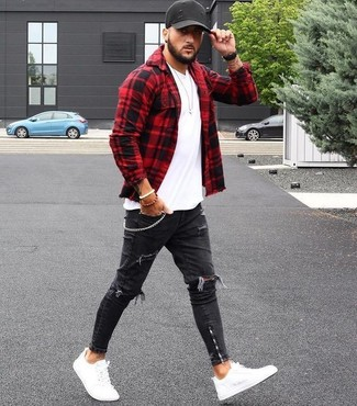 How to Wear a Red and Black Gingham Long Sleeve Shirt For Men: Wear a red and black gingham long sleeve shirt with black ripped skinny jeans and you'll be prepared for whatever this day throws at you. And if you wish to instantly amp up this outfit with one item, complete your outfit with a pair of white leather low top sneakers.