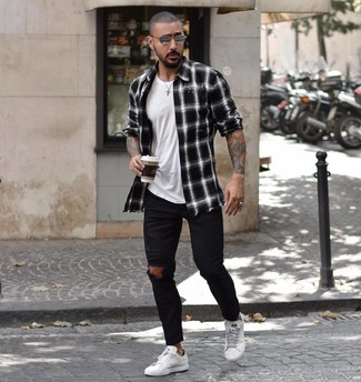 How to wear: black and white plaid long sleeve shirt, white crew-neck t-shirt, black ripped skinny jeans, white leather low top sneakers