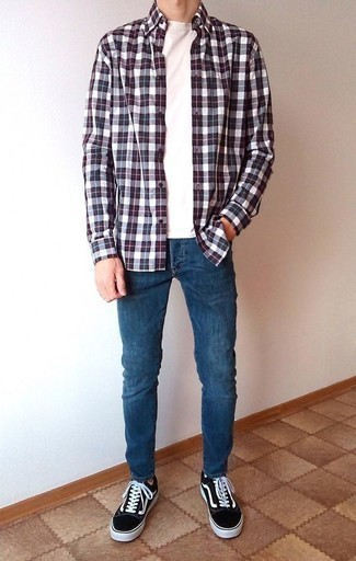 How to Wear Blue Skinny Jeans For Men: Wear a burgundy plaid long sleeve shirt with blue skinny jeans to achieve an interesting and modern-looking urban outfit. A pair of black and white canvas low top sneakers will put a smarter spin on this ensemble.