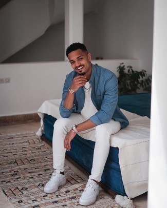 Blue Long Sleeve Shirt Outfits For Men: A blue long sleeve shirt looks so great when worn with white skinny jeans. Complete this ensemble with a pair of white leather low top sneakers et voila, this getup is complete.
