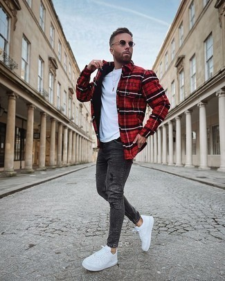 Red Flannel Long Sleeve Shirt Outfits For Men: Wear a red flannel long sleeve shirt with charcoal ripped skinny jeans, if you prefer to dress for comfort without looking like a slob to look dapper. White leather low top sneakers are guaranteed to bring an added touch of sophistication to this ensemble.