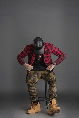 How to Wear a Red and Black Gingham Long Sleeve Shirt For Men: For an off-duty ensemble, reach for a red and black gingham long sleeve shirt and olive camouflage leather sweatpants — these two pieces work really well together. Hesitant about how to complement this getup? Rock a pair of tan suede casual boots to smarten it up.