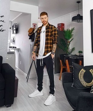 How to Wear a Black Plaid Long Sleeve Shirt For Men: This casual pairing of a black plaid long sleeve shirt and black sweatpants is a fail-safe option when you need to look dapper in a flash. Introduce white athletic shoes to the mix to keep the outfit fresh.