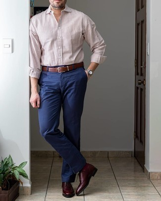 Brown Vertical Striped Long Sleeve Shirt Outfits For Men: Loving how this combo of a brown vertical striped long sleeve shirt and navy dress pants immediately makes you look polished and dapper. Add a pair of burgundy leather derby shoes to your outfit to change things up a bit.