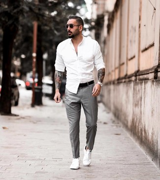 How to wear: white long sleeve shirt, grey dress pants, white leather low top sneakers, black leather belt