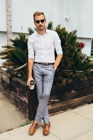 Light Blue Dress Pants Outfits For Men: Marrying a white long sleeve shirt and light blue dress pants is a surefire way to infuse your closet with some rugged refinement. Make a bit more effort now and complete your outfit with a pair of tan leather oxford shoes.