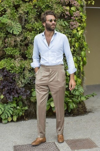 How to Wear a Silver Watch For Men: Wear a light blue vertical striped long sleeve shirt with a silver watch to feel 100% confident and look fashionable. Our favorite of a ton of ways to complete this ensemble is with a pair of tan leather tassel loafers.