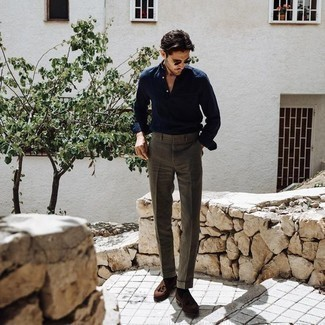 How to Wear a Navy Long Sleeve Shirt For Men: This ensemble clearly illustrates it is totally worth investing in such smart menswear items as a navy long sleeve shirt and brown dress pants. If you're puzzled as to how to round off, a pair of brown suede tassel loafers is a nice pick.