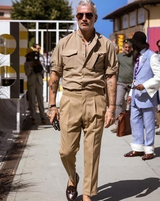 Tan Long Sleeve Shirt Outfits For Men: Marrying a tan long sleeve shirt and khaki dress pants is a guaranteed way to infuse personality into your styling repertoire. Dark brown leather tassel loafers will pull the whole thing together.