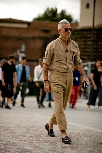 Khaki Dress Pants Outfits For Men: This sophisticated combination of a tan long sleeve shirt and khaki dress pants will be a true manifestation of your sartorial skills. Let your styling expertise truly shine by rounding off your ensemble with dark brown leather tassel loafers.