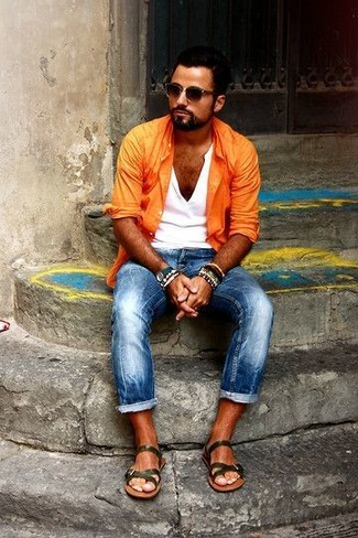 How to wear: orange long sleeve shirt, white henley shirt, blue skinny jeans, olive leather sandals