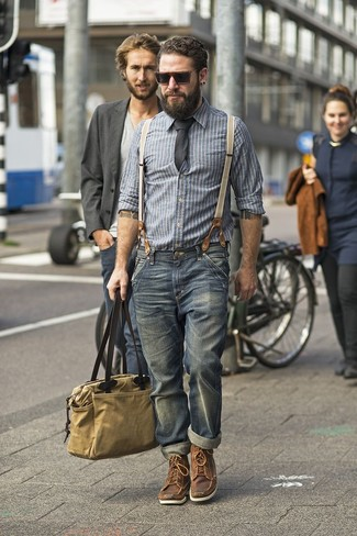 This combination of a grey striped chambray button-down shirt and navy jeans is perfect for off-duty occasions. Brown leather boots will add a touch of polish to an otherwise low-key look.
