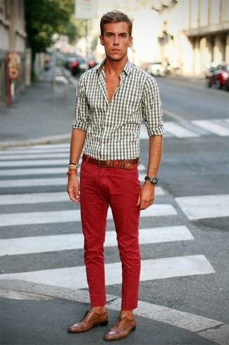 How to Wear Red Jeans For Men: Infuse style into your daily casual routine with a white gingham long sleeve shirt and red jeans. Finish with tan leather brogues to add a little kick to the getup.