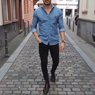 How to Wear a Blue Chambray Long Sleeve Shirt For Men: If you're looking for a casual but also stylish look, wear a blue chambray long sleeve shirt and black jeans. Get a little creative in the shoe department and complement this outfit with dark brown leather chelsea boots.