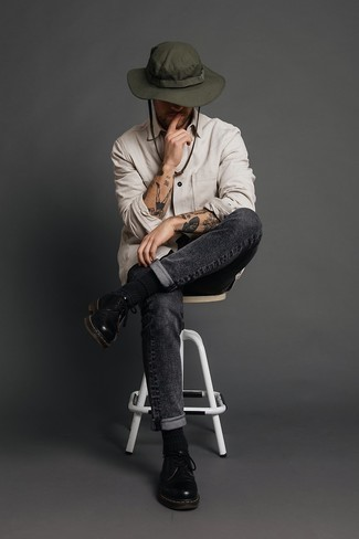 Charcoal Jeans Outfits For Men: Wear a beige long sleeve shirt with charcoal jeans for a no-nonsense ensemble that's also put together. Complement this outfit with a pair of black leather derby shoes for a dose of refinement.