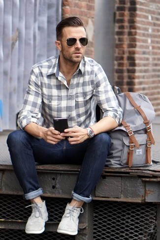 How to Wear a Silver Watch For Men: A grey check flannel long sleeve shirt and a silver watch are great menswear essentials that will integrate perfectly within your off-duty styling collection. Channel your inner David Gandy and complete this look with grey suede desert boots.