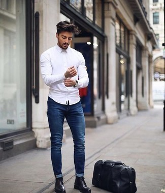How to Wear Black Leather Desert Boots: This pairing of a white long sleeve shirt and navy jeans is hard proof that a pared down off-duty getup doesn't have to be boring. Finish with black leather desert boots et voila, this outfit is complete.