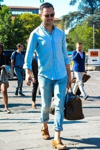 How to Wear a Light Blue Chambray Long Sleeve Shirt For Men: If you appreciate the comfort look, try teaming a light blue chambray long sleeve shirt with light blue jeans. You can get a little creative on the shoe front and polish off your getup with tan leather double monks.
