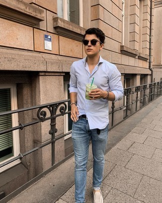 Blue Jeans Outfits For Men: For a casual ensemble, go for a light blue vertical striped long sleeve shirt and blue jeans — these two pieces go perfectly well together. Here's how to dial it up: beige suede loafers.