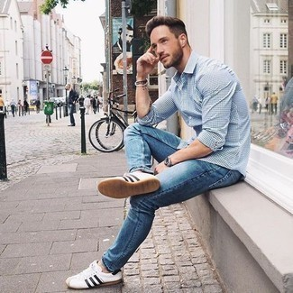 Dark Brown Bracelet Outfits For Men: Such pieces as a white and navy gingham long sleeve shirt and a dark brown bracelet are an easy way to introduce effortless cool into your current arsenal. Take your ensemble in a classier direction with a pair of white and black leather low top sneakers.