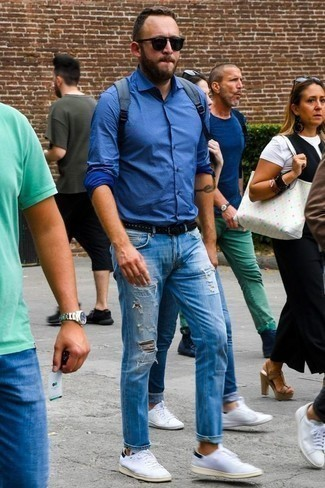 How to Wear a Blue Canvas Backpack For Men: Want to inject your wardrobe with some casual street style? Make a blue long sleeve shirt and a blue canvas backpack your outfit choice. White canvas low top sneakers will bring an added touch of class to an otherwise standard getup.