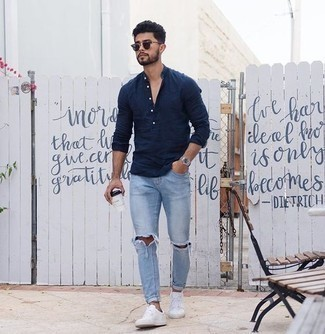 How to Wear Navy Sunglasses In Your 20s For Men: This modern casual combination of a navy linen long sleeve shirt and navy sunglasses is super easy to put together without a second thought, helping you look on-trend and ready for anything without spending a ton of time going through your wardrobe. When it comes to footwear, go for something on the classier end of the spectrum and finish this getup with white canvas low top sneakers.