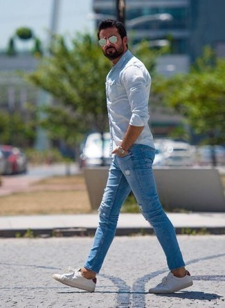 How to Wear White and Red Low Top Sneakers For Men: Why not try teaming a light blue long sleeve shirt with light blue ripped jeans? As well as super comfortable, these two pieces look amazing when worn together. Inject a hint of class into this look by finishing with white and red low top sneakers.