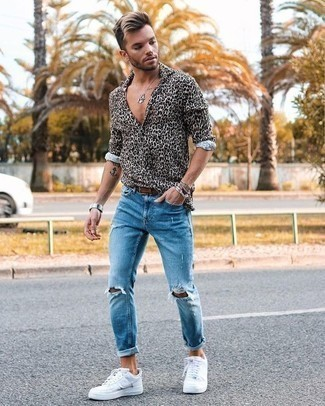 How to Wear Light Blue Ripped Jeans For Men: Choose a beige leopard long sleeve shirt and light blue ripped jeans for both stylish and easy-to-style ensemble. Here's how to bring a dose of sophistication to this outfit: white canvas low top sneakers.