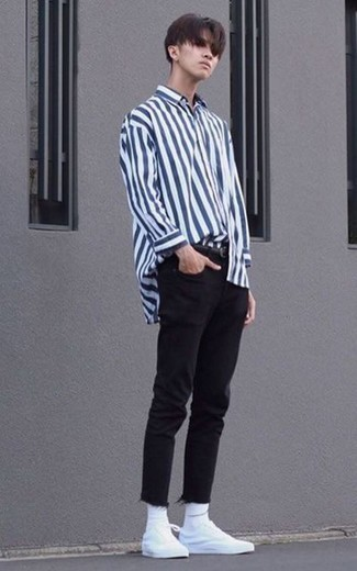 Black Jeans Outfits For Men In Their Teens: Opt for a white and navy vertical striped long sleeve shirt and black jeans to achieve new heights in your casual fashion game. If you don't know how to round off, complement your look with white canvas low top sneakers. When it comes to casual outfit ideas for teenage guys, this outfit is perfect.