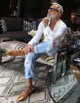Light Blue Ripped Jeans Outfits For Men After 50: A white long sleeve shirt and light blue ripped jeans are among the crucial elements in any man's great casual wardrobe. Introduce a pair of tan suede oxford shoes to the mix to easily kick up the classy factor of any ensemble. Dressing inspiration like this will help you remain incredibly fashionable even in your fifties.