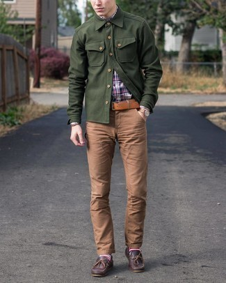 Dark Brown Leather Boat Shoes Outfits: This relaxed casual pairing of a white and red and navy plaid long sleeve shirt and brown chinos couldn't possibly come across as anything other than ridiculously stylish. A cool pair of dark brown leather boat shoes pulls this ensemble together.