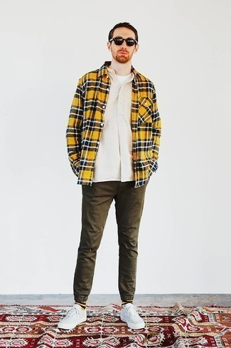 Olive Chinos Casual Outfits: This combo of a beige long sleeve shirt and olive chinos is a cool ensemble for when it's time to clock off. White canvas low top sneakers will add a hint of stylish effortlessness to an otherwise standard getup.